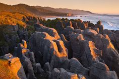 As you travel down the West Coast of New Zealand, you'll drive through a small community called Punakaiki which is roughly halfway between Westport and Greymouth.  Punakaiki is best known for its Pancake Rocks and Blowholes, both of which are spectacular and a must-see attraction for tourists. http://www.newzealandbyroad.com/top-10-best-places-to-visit-in-new-zealand/