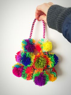 Peruvian PomPom Tassles — PresentlyIn Pom Pom Crafts, Yarn Crafts, Diy Arts And Crafts, Diy Crafts, Mexican Fiesta Decorations, Sewing Projects, Craft Projects, Pom Pom Decorations, Do It Yourself Design