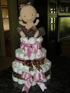 Baby Diaper Cake: I made this Baby Sophia Diaper Cake with size 1 Pampers Swaddlers diapers.   I bought a 92 ct box but did not use all of the diapers. I will give my friend