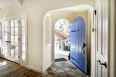 Blue, arched, entry door.