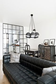 Beautiful black leather tufted sofa,industrial furniture with black & white interior design.