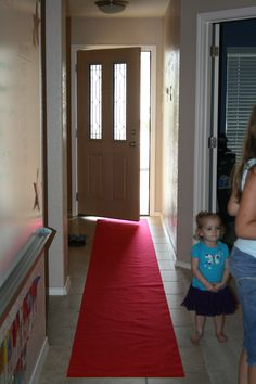 Movie Theater themed birthday party- we rolled out the red carpet which I bought at party city for 6 dollars.