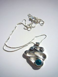 Sterling silver switchback pendant.