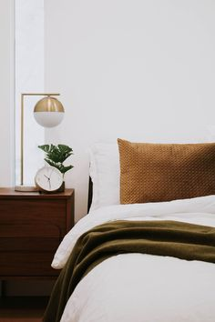 Modern and cozy bedroom by Nadine Stay. Velvet pillow and hunter green army blanket on a linen comforter. Brass accents in this neutral bedroom. Interior, Bedroom Makeover, Home Bedroom, Cheap Home Decor, Home Decor, House Interior, Modern Bedroom, Modern Bedroom Decor, Remodel Bedroom