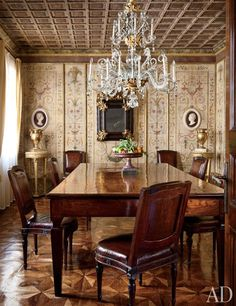 The magnificent, historically inspired dining room of a venerable family home outside Venice, Italy