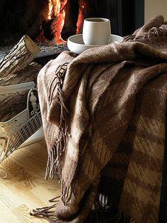 A cup of warm tea and cosy tartan blanket