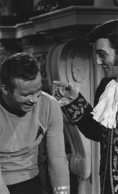 """William Shatner and William Campbell pause for a laugh during the filming of """"The Squire Of Gothos."""""""