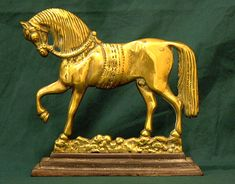 Antique Prancing horse brass door stop. This antique brass horse door stop measures 10 inches wide and 9 and one half inches high with a 3 inch deep cast iron base. Vintage Decor, Vintage Antiques, Door Stopper, Carousel Horses, Iron Doors, Elegant Homes, Brass, Copper, Lion Sculpture
