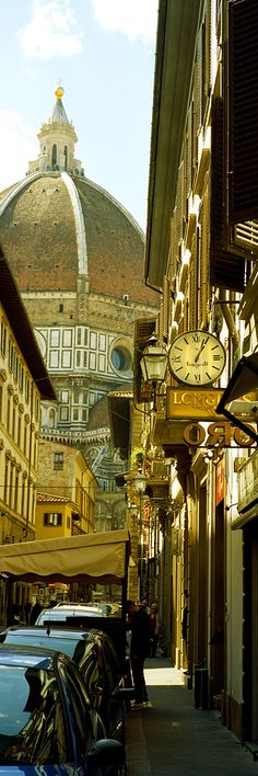 Cars parked in a street with a cathedral in the background, Via Dei Servi, Duomo Santa Maria Del Fiore, Florence, Tuscany, Italy - Canvas Print by Panoramic Images