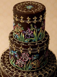 An unlikely trio—Russian folk art, irises, and her grandmother's painted metal TV-dinner trays—inspired Dianne Holgate. To achieve the gradations of color in the flowers, she applied liquid royal icing to stenciled designs, then shaded them with a brush. Fondant cake with piped beads, fleurs-de-lis, stringwork, and brush-embroidered irises and forget-me-nots.
