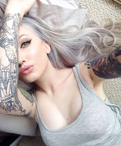 silver hair tattoo girl, effect of colored silver hair paired with tattoos