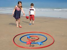 For an easy version of this game at the beach, draw circles in the sand and use shells as bean bags- just make sure the shells are uninhabited first!