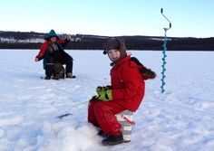 Ice fishing in Lake Puolamajärvi in Pello in Finnish Lapland
