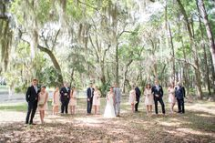 #southernwedding #uniquebridalpartyphotos #vogue #weddingparty #Bridalparty  Groomsmen in navy Zara suits and bridesmaids in short pink Bill Levkoff dresses. Wedding party at Haig Point, South Carolina, off the coast of Hilton Head. Photos by Mikkel Paige Photography. Baby's breath bouquets and succulent boutonnieres complete the look.