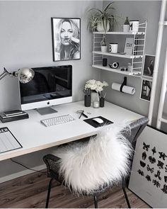 Grey walls and white desk