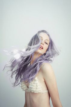 silver purple tinted hair. She looks like a mermaid!
