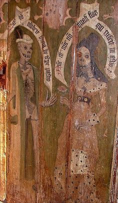 A female skeleton offers a flower to a male skeleton, in a pardoy of the sacrament of matrimony. From the 1490s Dance of Death sequence on the rood screen at Sparham in Norfolk