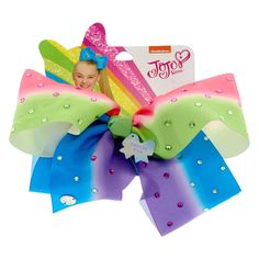 Jojo Siwa Dancing Diva Rainbow Signature Hair Bow | Get the ultimate JoJo Siwa super fan bow with this large dancing diva bow from the JoJo Siwa collection. This bow is attached to a metal salon clip making it super easy to wear. The rainbow material is covered in pretty multi-colored rhinestones. You'll sparkle from head to toe like Jojo, the dancing diva herself!