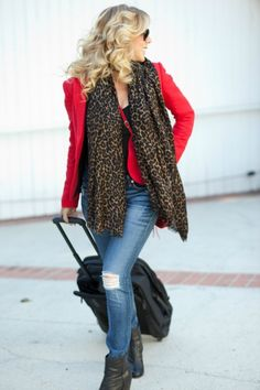 Michelle Chiklis travel fashion red leopard suitcase MoveLifeStyle