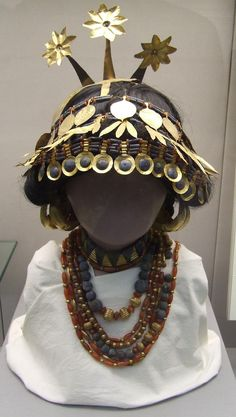 Sumerian necklaces and headgear discovered in tombs, showing the way they may have been worn. British Museum. Link is to an article about Mesopotamian trade and merchants.