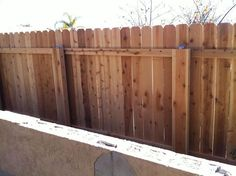 Building a wooden fence over metal poles