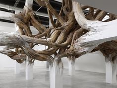 Architectural Columns at the Palais de Tokyo Explode into Organic Forms wood installation architecture by Brazilian artist Henrique Oliveira. Organic Sculpture, Wood Sculpture, Sculpture Projects, Installation Architecture, Architecture Design, Organic Architecture, Building Architecture, Land Art, Architectural Columns