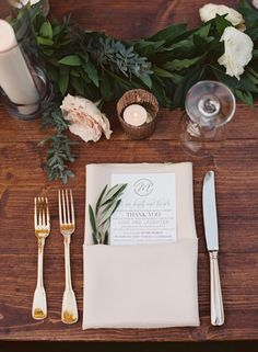 Greenery Centerpiece on a Farm Table with Gold Flatware