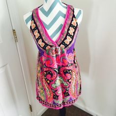 Angie dress Super cute hippie dress. Lots of different colors. Very stretchy with no zipper. In great shape other than 2 tiny unnoticeable holes on the back top shoulder. Angie Dresses