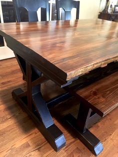 We custom build farmhouse tables.  We ship anywhere in the United States.  The table pictured is stained in Special Walnut with a lightly distressed black x-frame base.
