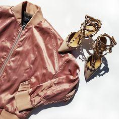 Fashion flatlay featuring Neuw silk bomber jacket and Valentino nude pumps
