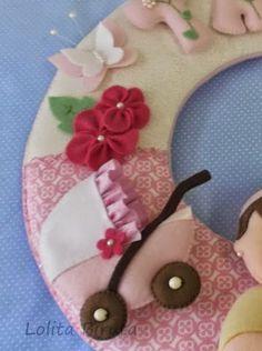 Carrinho de bebê em feltro para meninas