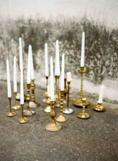 A mis-matched collection of vintage brass candlesticks.