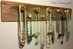 Attaching antique / vintage wooden spools to a piece of salvaged wood creates a unique, attractive, and effective rack for your necklaces and jewelry. #sadieseasongoods
