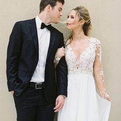 Lillian West Wedding Dresses Style 6422 -Feel dreamy in this feminine chiffon A-line gown with an illusion V-neckline; lace appliqués on the sleeves and sheer back; and a dropped waistline. This gown is completed with a chapel length train.