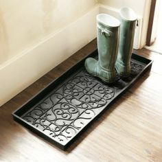 French Axis Rubber Boot Tray - Virtually Indestructible.  Indoors our outdoors - it looks like a good idea!