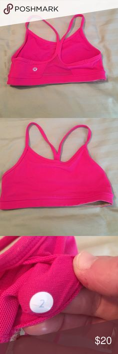 Lululemon power y sports bra size 2 Briefly worn, still in great condition. Have pads to insert. Color is hot pink lululemon athletica Tops