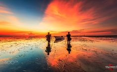 Lucky Morning in Bali - I was very happy in this time with awesome warm morning , with 1 of best landscaper too and my friend member of 500px too from India . After raining at night and suddenly stop about 4 o`clock in the morning , before sunrise the sky is come out true colour . Amazing .. So i just take them as foreground with a boat in the middle , so lovely frame to me and Thanks God always give me a special morning . If anyones in here get holiday in Bali during in that time can…