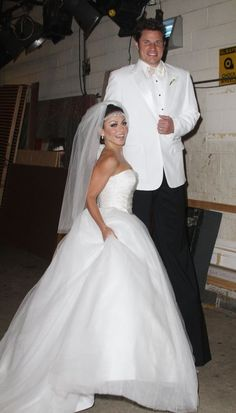 Halloween couples costume inspiration: Kelly Ripa and Nick Lachey as Kim Kardashian and Kris Humphries on their wedding day. Perfect for the couple with at least a foot in height difference.