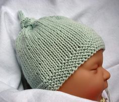 A quick and easy knit baby hat with sizes from preemie to 2 years. It is knit in the round so that there are no seams to add pressure on a newborn's head. The top knot can be adjusted to make the hat shorter or longer in height - an invaluable advantage f