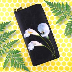 Flower collection by Malvi, made with vegan and Eco-friendly materials. This calla lily large wrislet wallet has matching cross body bag, small pouch and medium pouch. Wholesale available at www.mlavi.com. Shop now at https://mlavi.ca/search?page=1&q=flower&type=product #flower #vegan #fashion #accessories #gift #wholesale #wallet #bag #purse #pouch #shopping