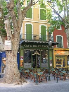 Café in the South of France --- Jerry and I sat out on something like this; had a banana split - $8 back then - so worth it!