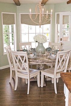 Eat-In Country Kitchen With Round Dining Table and Hardwood Floors