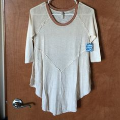 Free people tee NWT Scoop neck. Lightweight material. Asymmetrical hem. Perfect for leggings, back covers behind. Size medium. Free People Tops Tees - Long Sleeve