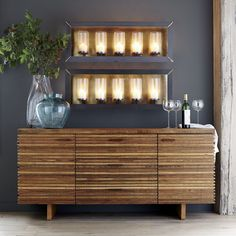 A modern piece with a rich history, the Paloma sideboard is the story of timber reclamation from around the world.  Paloma's distinctive door fronts feature dynamic stacking of precision-cut strips of peroba wood reclaimed from Brazilian homes no longer in use.  In organic contrast is a solid slab top of ironbark hardwood, recouped from Brisbane's historic Hornibrook Highway Bridge, demolished by the Australian government in 2011.