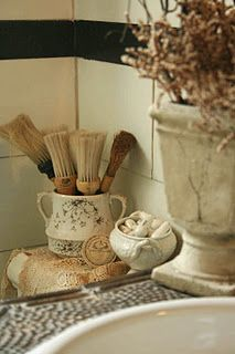 Bathroom vignette....love the shaving brushes