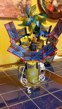 Birthday Bouquet with lotto tickets, chocolates, gum and a mini bottle of Jack Daniel's.
