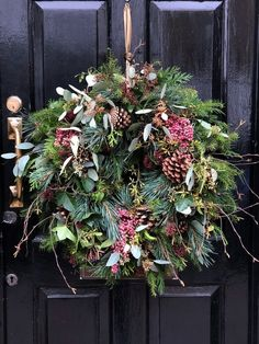 love this rustic christmas wreath with fir, pine cones, eucalyptus, poink peppercorns and twigs by The Real Flower Company. click through for inspiring DIY Christmas wreath ideas you'll love to try wreaths Make a contemporary Christmas wreath Christmas Wreaths To Make, Christmas Flowers, Holiday Wreaths, Rustic Christmas, Christmas Fun, Christmas Decorations, Holiday Decor, Artificial Christmas Wreaths, Christmas Swags