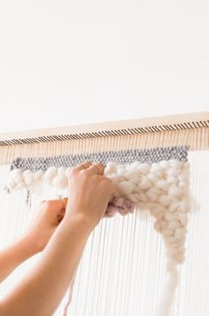 Learn how to make a DIY weaving loom with a few pieces of wood and some nails - for under $20! Instructions for a giant standing loom + a smaller lap loom.