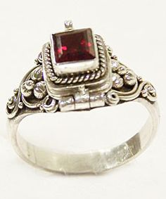 Garnet poison ring. Okay, so just let me rant for a second. I want one of these fucking things so bad that it's not even funny. I MEAN, IT HAS A SECRET COMPARTMENT. One day.