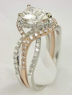Pear Shaped Diamond Engagement Ring in White Gold with Rose Gold Trim. Love this but with round diamond!!